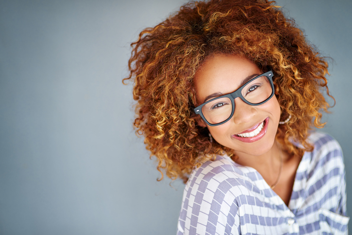 Woman smiling from cosmetic dental treatment at Ford Dental Group in Huntington Beach, CA